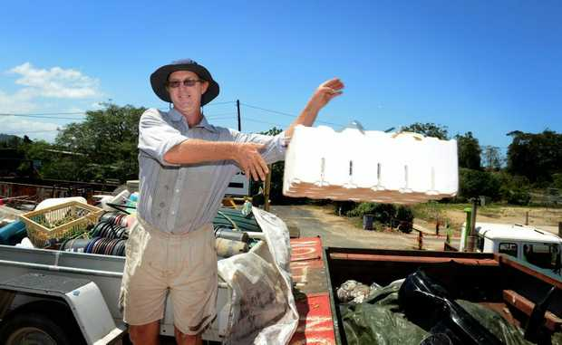 David Montgomery dumps some flood rubbish at Stotts creek tip.