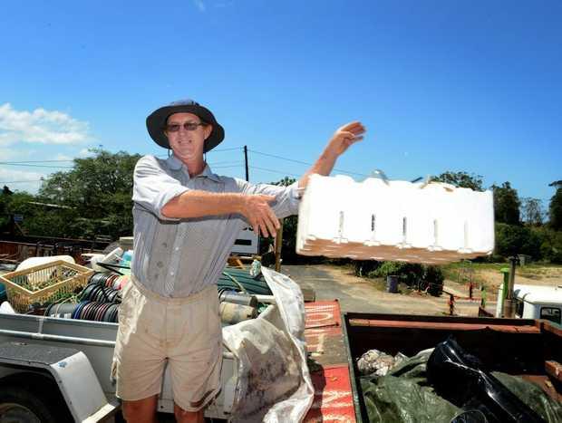 David Montgomery dumps some flood rubbish at Stotts creek tip.