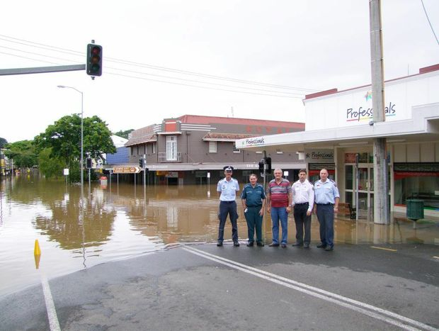Local Disaster Management Group of Gympie Police OIC Graeme Reeves, Gympie Ambulance OIC, Cr Wayne Sachs, EMQ area director Tim Steele and QFRS area co-ordinator Russell Thompson in Mary St.