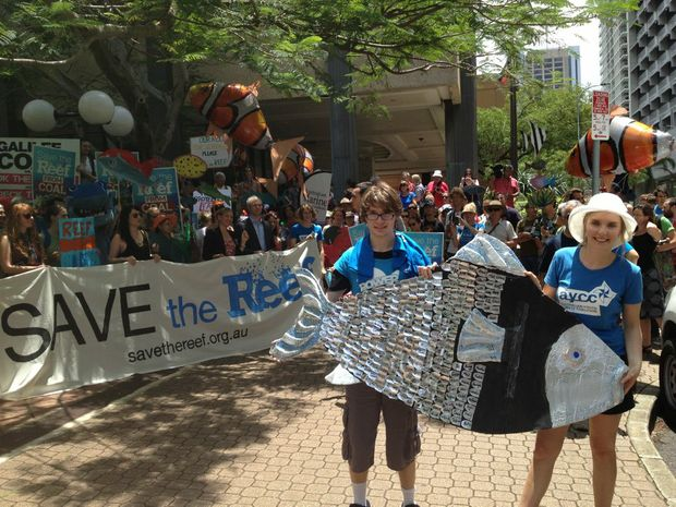 Protestors signed an over-sized fish at Save the Great Barrier Reef protest outside the Queensland Government's executive building in Brisbane.