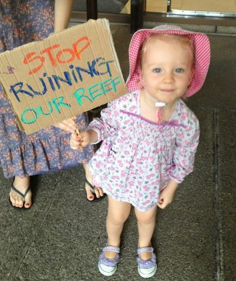 Imogen Barker, from the Gold Coast, at the Save the Great Barrier Reef protest outside the Queensland Government's executive building in Brisbane.