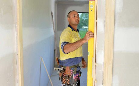 Fergus Builders' carpenter Chance Brown has plenty of material to continue working, despite floodING limiting some supplies. The building industry in the Mackay region is looking forward to a busy year.