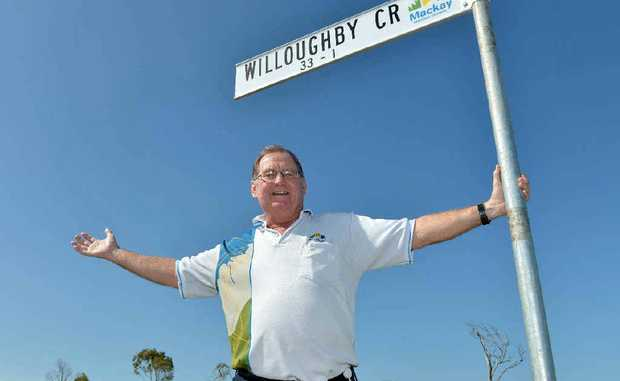 Deputy Mayor Kevin Casey with the new street names at the East Gordon Street development that take their inspiration from some of Sydney's suburbs.