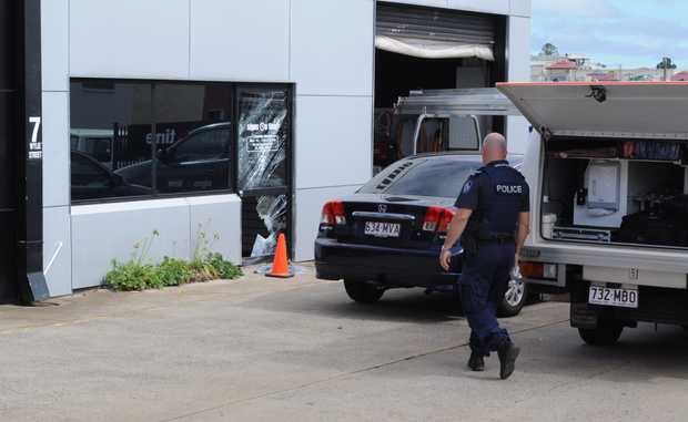 Police forensic crews assess the scene of a possible break and enter at a Wylie St business.