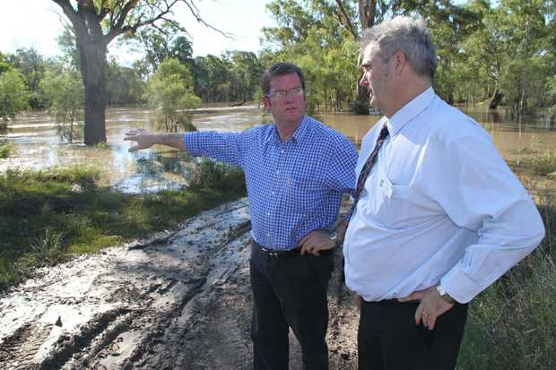 Agriculture minister John McVeigh surveys the Condamine River on Wednesday afternoon with mayor Ray Brown.