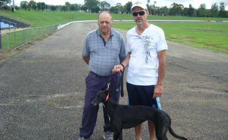 Col Byers (left) and Mark Saal inspect the former Toowoomba Showgrounds greyhound