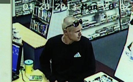 An image taken from CCTV footage of the armed robbery of a Banora Point video store on January 28, 2013. Photo Contributed