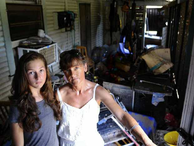 CLEAN START: Leisa and Linda Miles start putting their Copmanhurst home back together after it was completely submerged in floodwaters. Photo: JoJo Newby