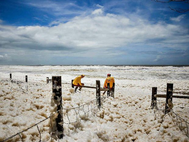 """FROTH AND BUBBLE: Little Mountain photographer Caillin Malley caught two surf lifesavers """"patrolling"""" Alexandra Headland's beach froth this week."""
