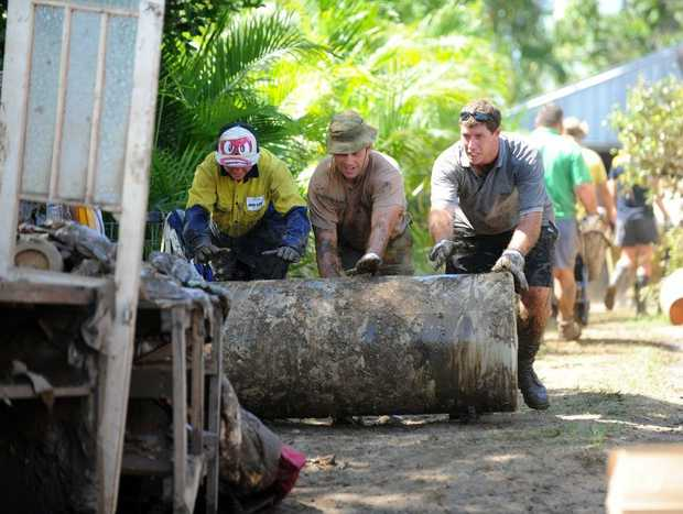 TEAMWORK: The community together with the army helped with the clean-up of flood damaged North Bundaberg. Photo: Mike Knott / NewsMail