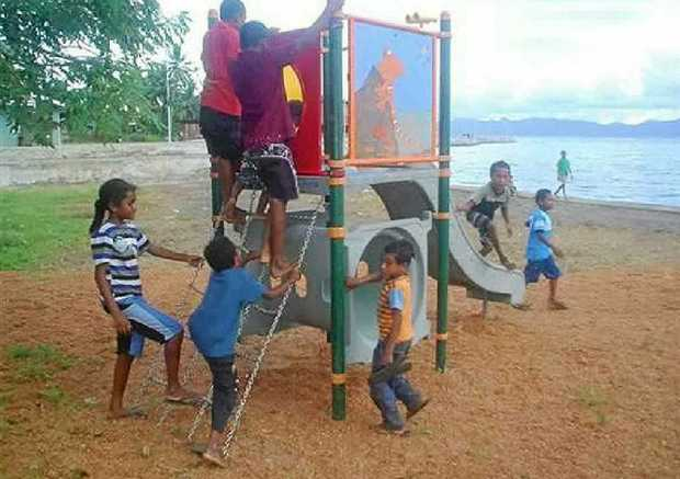 SECOND LIFE: Children in the PNG village of Alotau enjoy playground equipment donated by Sunshine Coast Regional Council.