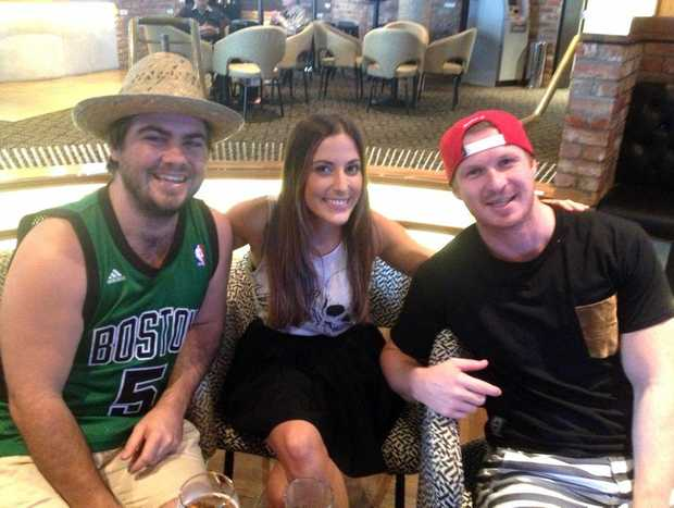 Brock Nielsen, Samantha Hurst and Brent Nicholls watching the Super Bowl at Twin Towns Tavern.