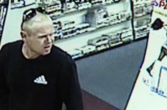 CCTV footage of the man police wanted to speak to over an armed robbery at Banora Point,last month.