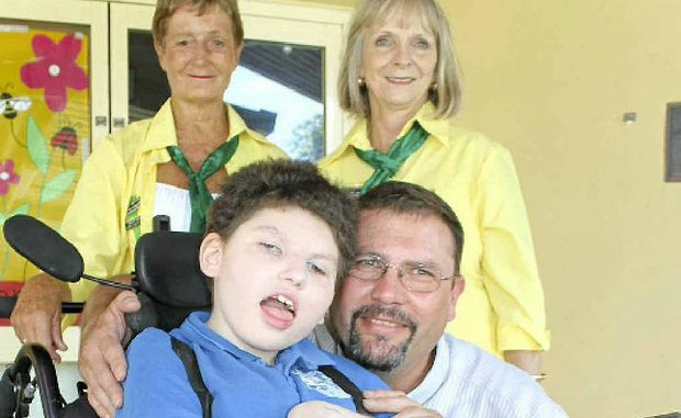 HELP: A fundraiser has been organised to buy a wheelchair-access car for Georgia Molan's family of Alstonville. Pictured are Georgia and her Dad, David, and Ballina Scope Club members Ruth Gradwell and Glenys Davidson.