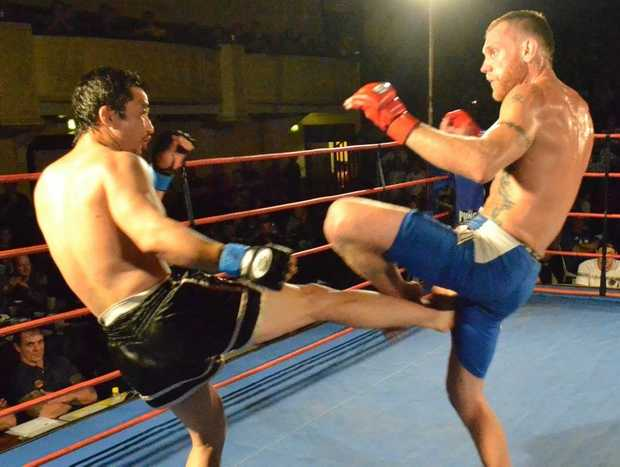 Mixed martial artist Greg Atzori in action against Terry Balboa in Adelaide.
