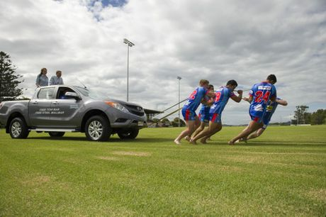 PULLING POWER: Clydesdales players (from left) Tommy Orcher, Hayden Edmonds, Luke Ash, Sean Hamel and Josh Birch pull a ute containing sponsors David Russell from Wippell's Autos and Anna Gundry from Wagners.