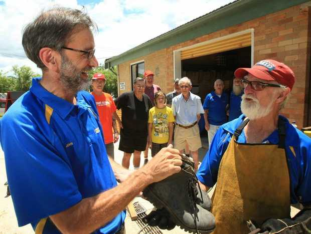 Big Shoes to Fill! John Pitt is handing over the shoes to Michael Newell at Murwillumbah Men's Shed.