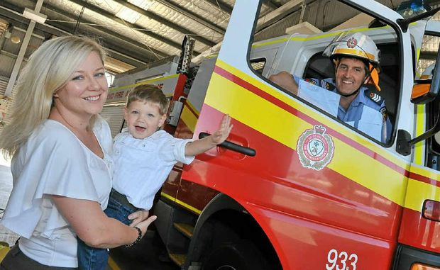 Firefighter Matt Foster and his wife Julie-Anne and son Samual.