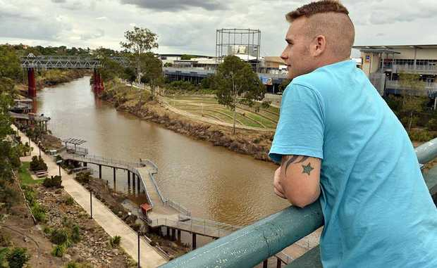 OPEN TO VIEW: Pedestrian Ross Taylor admires the riverside scene from the uncaged David Trumpy Bridge.