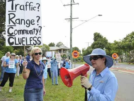 Friends of the Toowoomba Range spokeswoman Kate Powell leads more than 100 demonstrators opposing the development of Eastside Village.