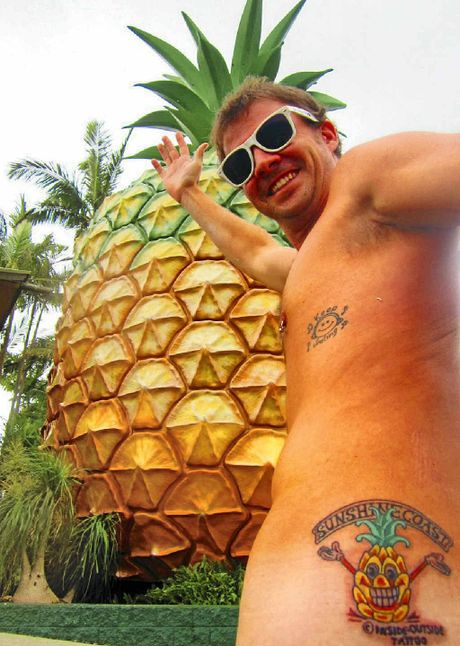 DEDICATED FAN: Dan Munro sporting his tattoo in front of the Big Pineapple.
