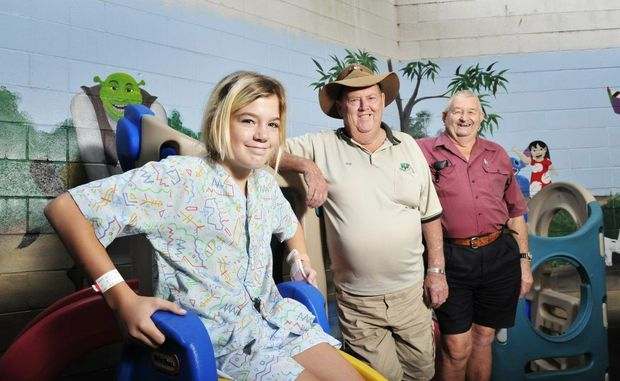 Ipswich Hospital's Sunshine Ward patient Lily Darby, of Laidley, with Happy Wanderers trip co-ordinator Bob Green and passenger Phill Smith. Photo: Rob Williams / The Queensland Times