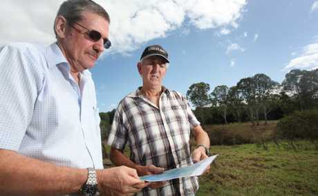 Paul Casbolt and Peter Jenkyn on his property at Logan Reserve where new power lines have been proposed. Photo: Inga Williams / The Reporter