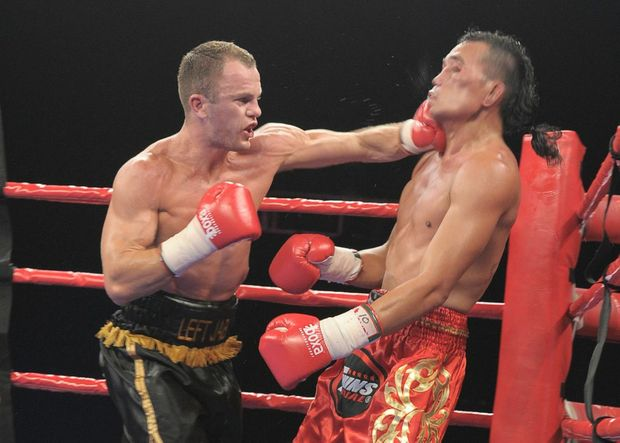 Jarrod Fletcher rocks Thailand's Kiatchai Singwancha with a left hook at the Brisbane Entertainment Centre.