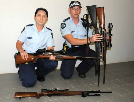 Constables Kim Black and Aaron Delphine with firearms seized from Gympie on Friday and Saturday.
