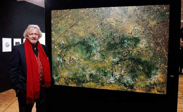 HONOUR: Boonah artist Dany Weus pictured with his painting Colours of Water #2 which was displayed in the Louvre last December.