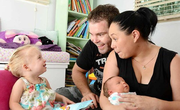 Lilliana Robertson with her parents Matia and Dale and eight-day-old sister Adelina.