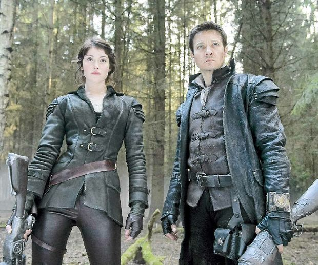 EQUAL PARTNERS: Gemma Arterton (Gretel) and Jeremy Renner (Hansel) in a scene from the movie Hansel & Gretel: Witch Hunters.