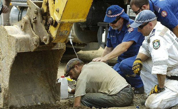 """Protester Matt Graham chained himself to a pipe anchored in the ground called a """"dragon"""" to try and stop trucks from entering the Doubtful Creek mining site. Police Rescue with the aid of Paramedics worked for over seven hours to free him."""