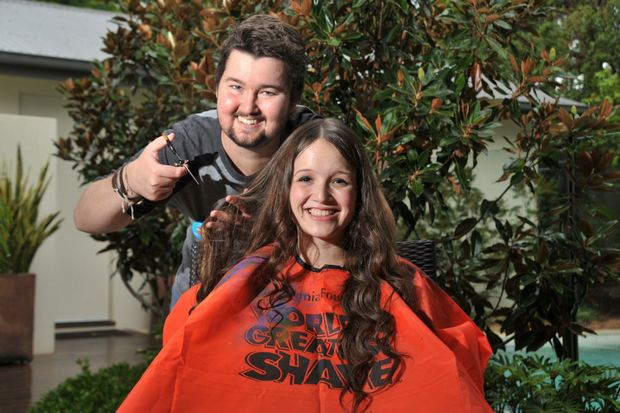 Rebel Lyons is shaving off her luscious locks for charity at World's Greatest Shave next month, pictured here with Adem Crosby. Photo: Iain Curry / Sunshine Coast Daily