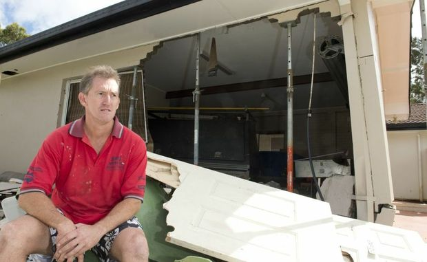 Paul Elbourne surveys the damage to his Luck St home garage.
