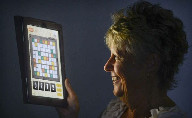 Sue Kearney with her newly developed iPad app Sudoku Flick.