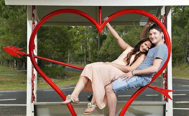 REAL ROMANTICS: Brooke Searle and Matt Breed at the Lovers Lane bus stop at Ironbark.