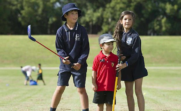 GOLF FUN: Spending the afternoon playing golf are (from left) Michael Brown, Aiden Craig and Samantha Brown.