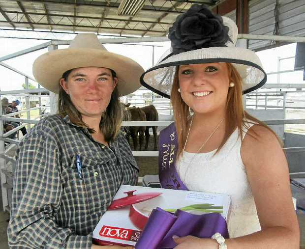 GLORY: Meleeka McGregor of Allora, exhibited the Champion Female of the Allora Show and is presented with her prize by 2013 Allora Showgirl, Carla Frizzell.