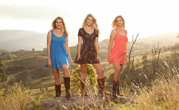 COMING TO BIGGENDEN: Three sisters going by the name of Dozzi are looking forward to being in Biggenden for Saturday night's fundraiser for the AGL Rescue helicopter.