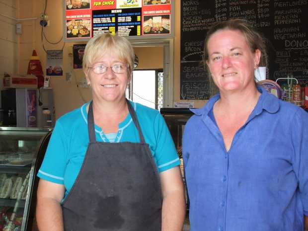 BACK IN BUSINESS: Those who thought Hester Moore (right) wouldn't re-open underestimated her toughness. Helping her through the massive clean-up was staff member Lyndal Summers.