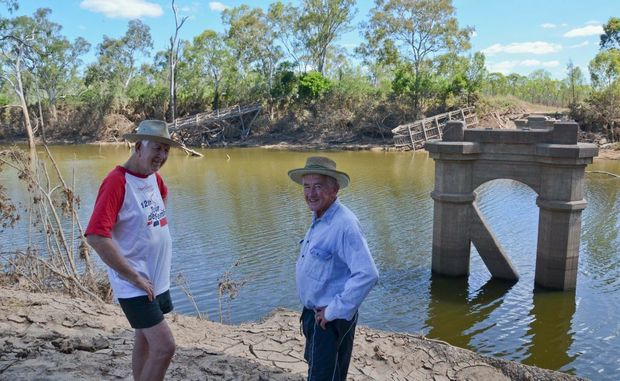 HERITAGE GONE: Bill and John Mellor survey the damage to Reids Creek Bridge.