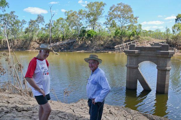 HERITAGE GONE: Bill and John Mellor survey the damage to Reids Creek Bridge.