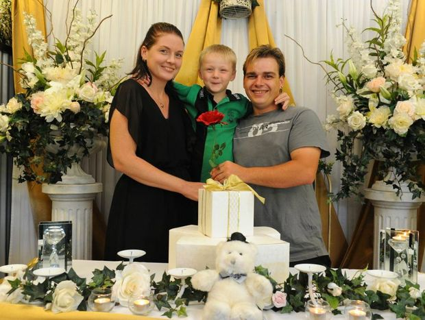 HERE COMES THE BRIDE: Bride Casey Franks and her son Tyler Leather with groom Steven Fletcher are excited about their wedding today thanks to their community who pitched in to get their wedding happening after the venue and reception location was flooded. Photo: Mike Knott / NewsMail