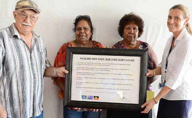 Brett Green, Aunty Sandra Malone, Aunty Lillian Burke and Heather Kelly at Gympie State High School yesterday, with a framed signed extract of Kevin Rudd's apology to aboriginal and islander Australians.