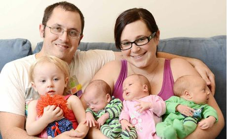 NEW ADDITIONS: Ipswich couple Michelle and Cameron Duncan at the Ipswich Hospital with their naturally conceived triplets, Sebastian, Violet and Max, born at 34 weeks, and their 19-month-old daughter Isabel.