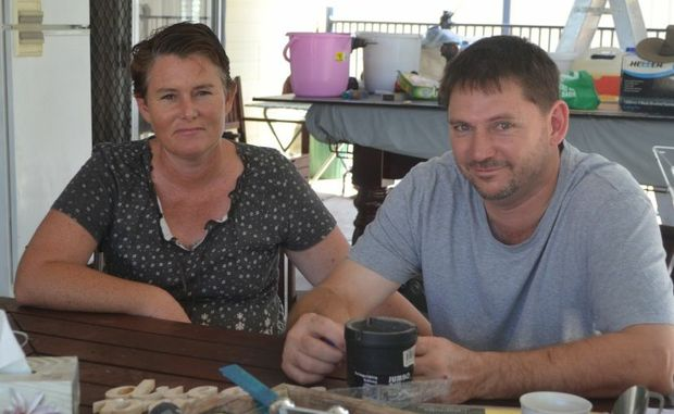 Carly and Tony Partridge say Maranoa Council should help them raise their Gregory St home which has been flooded three times in two years.