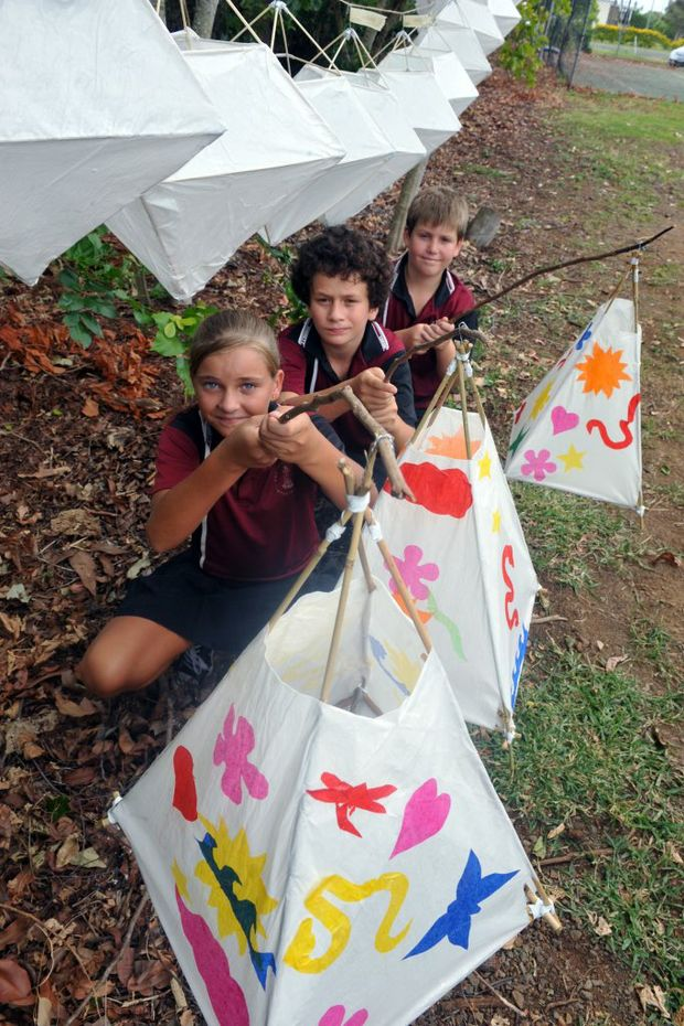 GET CRAFTY: Burnett State School students Jade McQualter-Walsh, Lincoln Kinsela and Parker Lamont make Chinese lanterns in preparation for Chinese New Year celebrations. Photo: Max Fleet / NewsMail