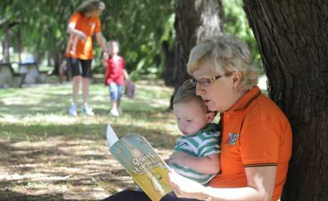 In training for the inaugural Pyjama Foundation fundraising walk are Helen Benham and with three-year-old Jonte Walker and Riley Walker being read to by Helen Yeo.