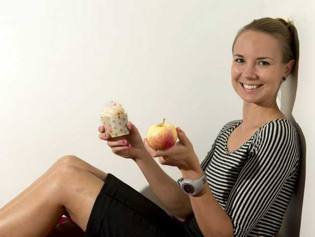 Dietitian Susanna Mihalik with the choices for breakfast. Photo Nev Madsen / The Chronicle